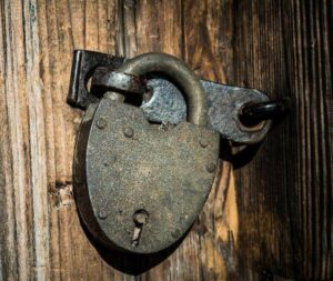 padlock on wooden backdrop