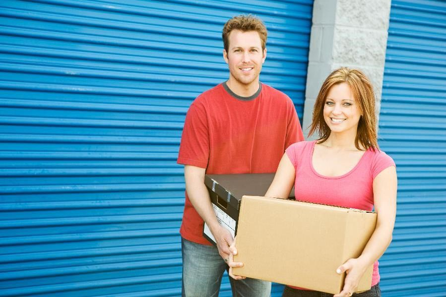 couple in front of storage unit