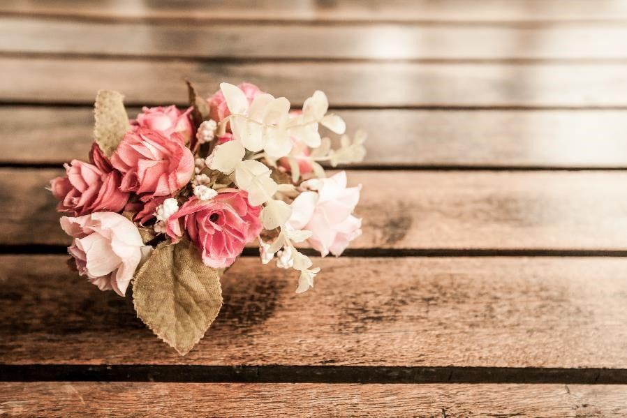 A bundle of flowers resting on a table