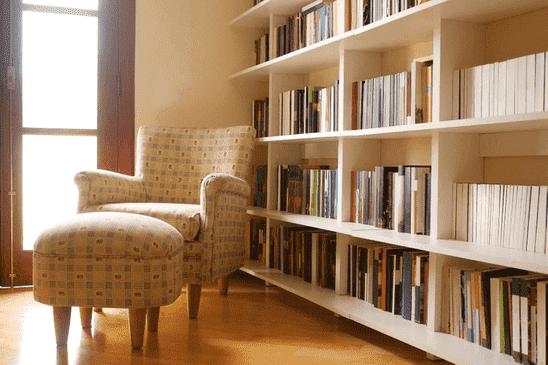 A very full bookshelf with books