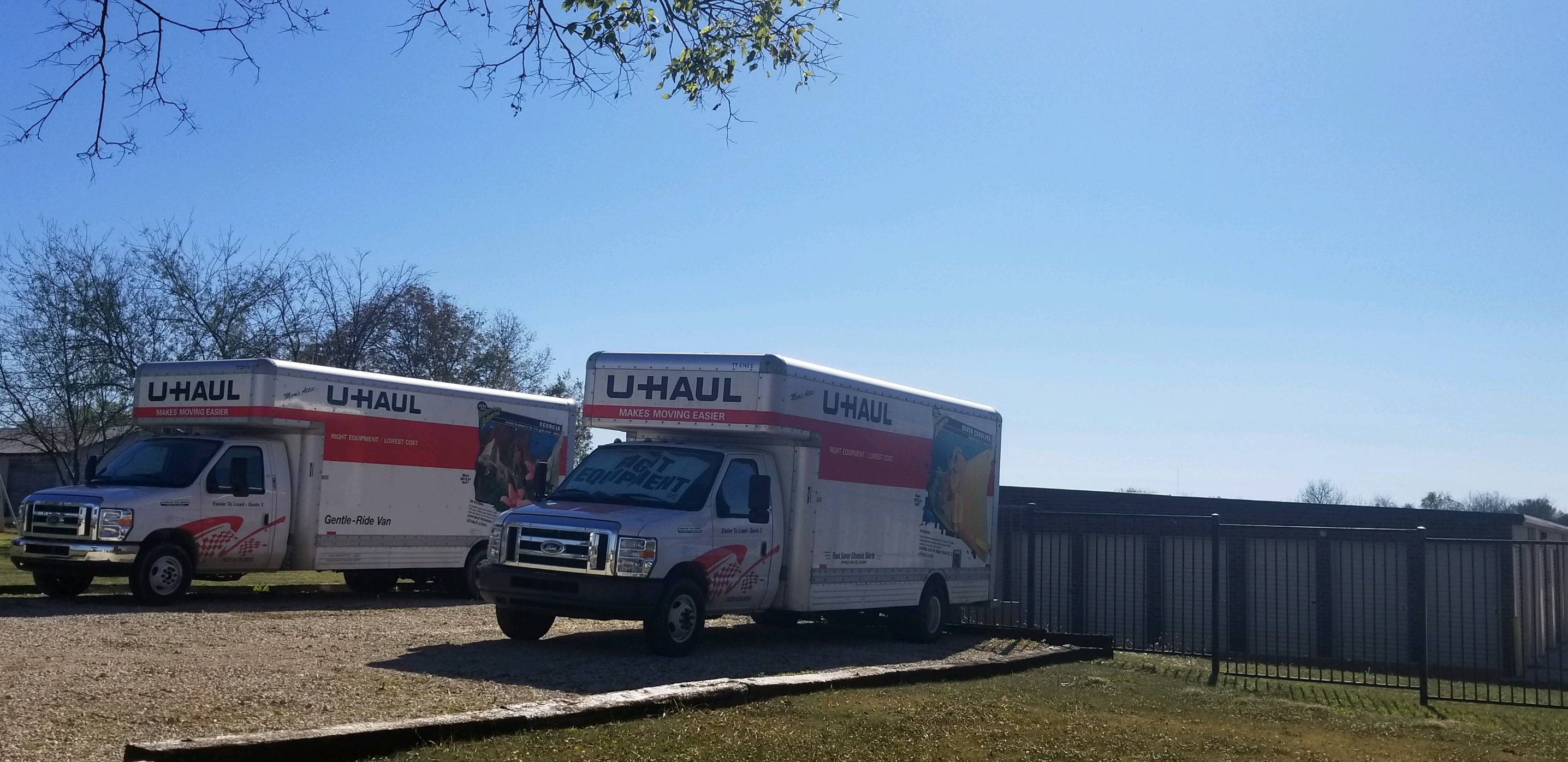 U-Haul moving trucks parked outside near outdoor storage units