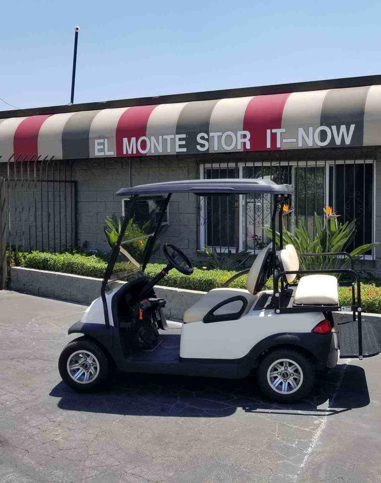 A golf cart parked outside of the El Monte Stor It-Now facility