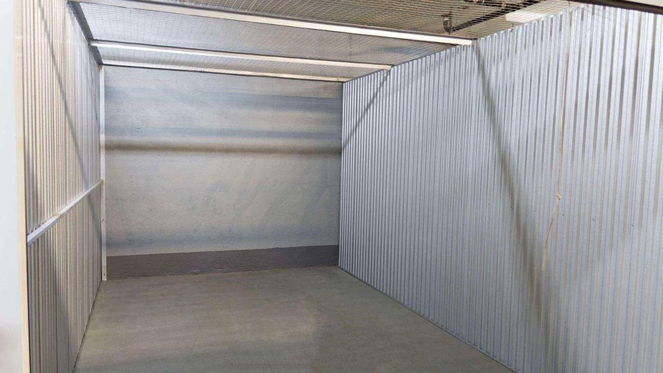 A view inside a large storage unit that is empty and clean