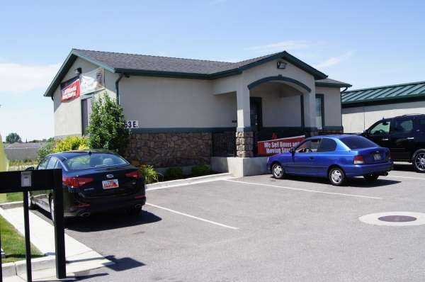 Exterior view of self storage facility office and parking lot area