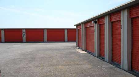 Area of outdoor storage units with large orange doors
