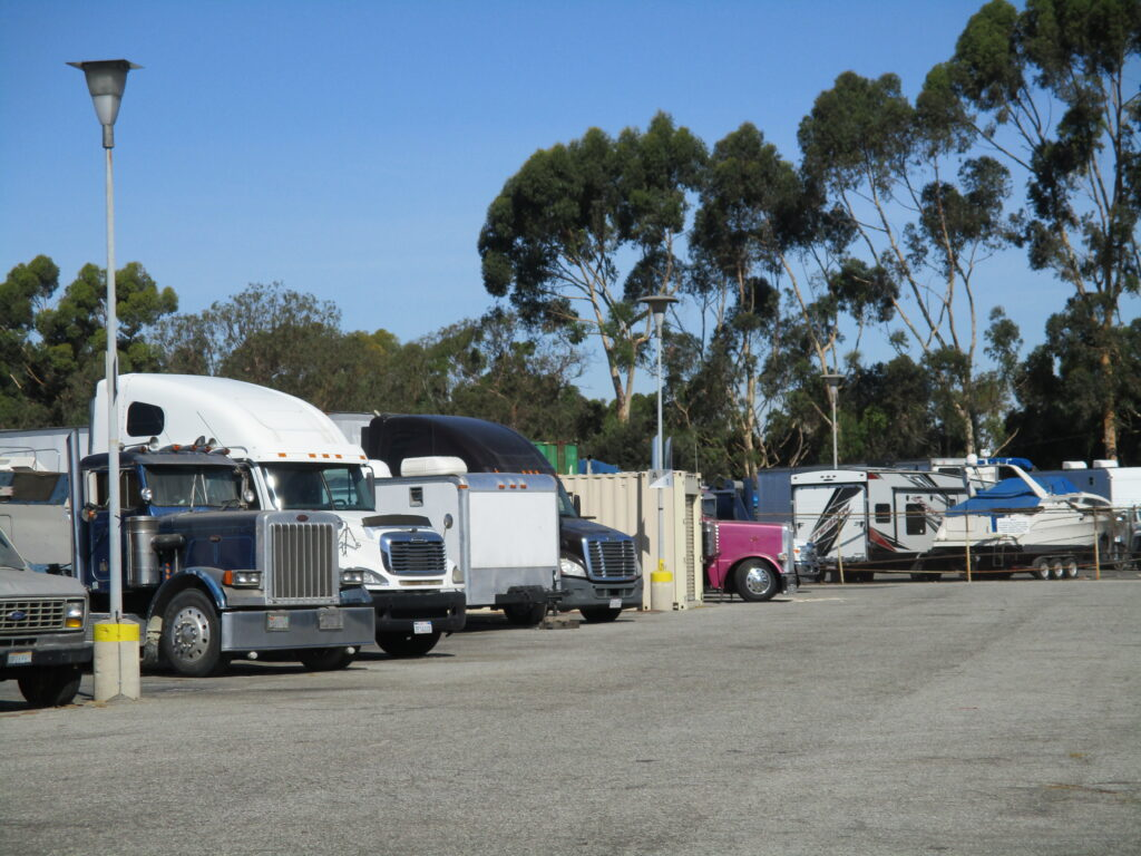 Outdoor parking lot area with trucks and trailers parked