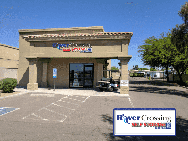 Entrance to the River Crossing Self Storage office with a gated entrance to outdoor storage units