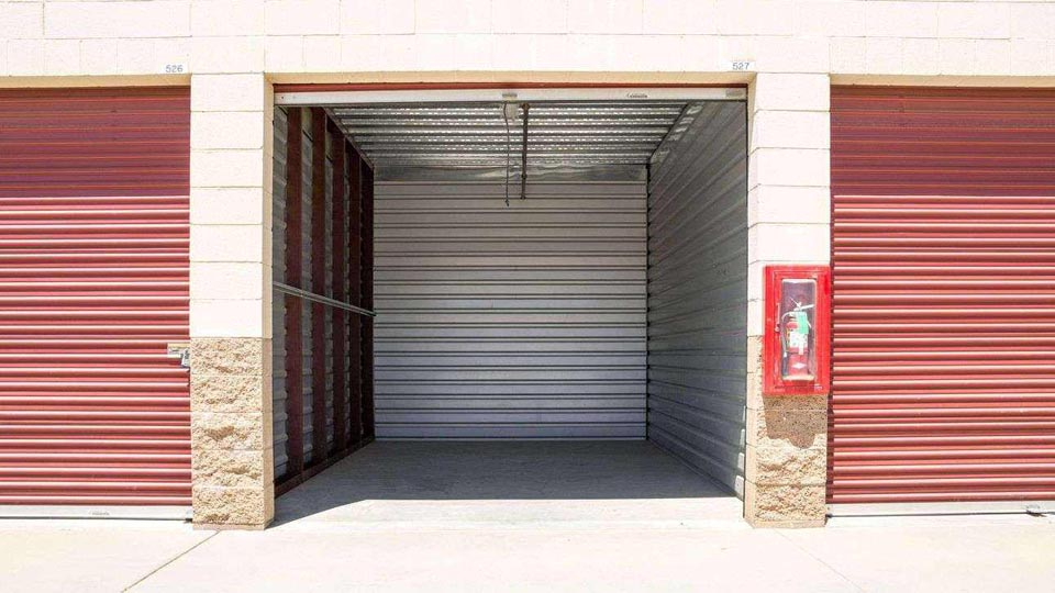 Inside look into a clean outdoor storage unit that is empty