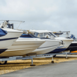 Outdoor parking area with boats lined up next to each other