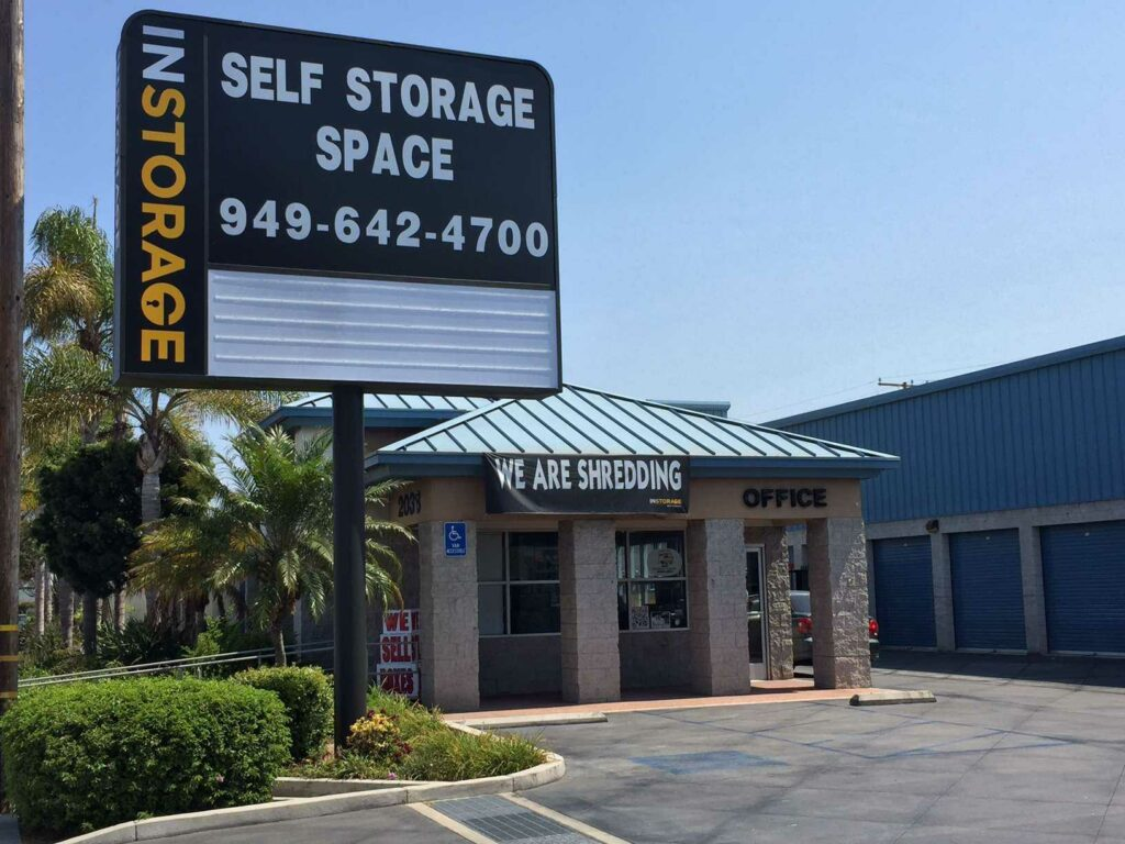 Entrance to Instorage Self Storage Space office with a large street sign