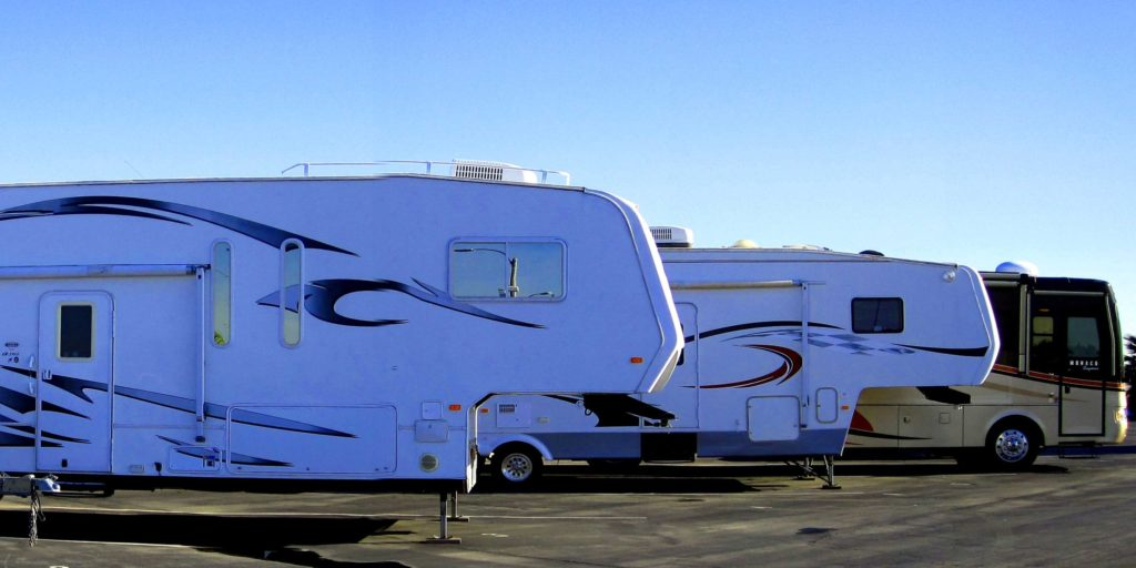 RVs parked next to each other outside