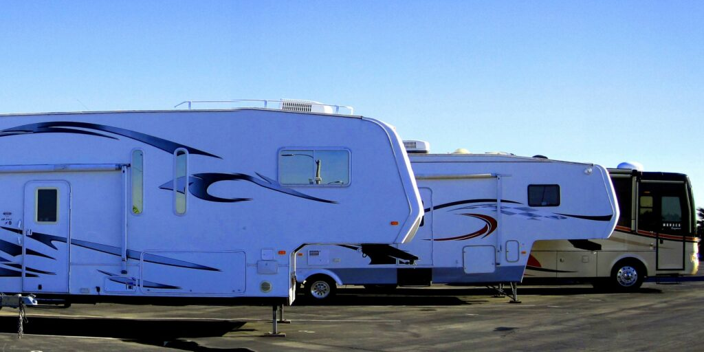 RVs parked outside next to each other