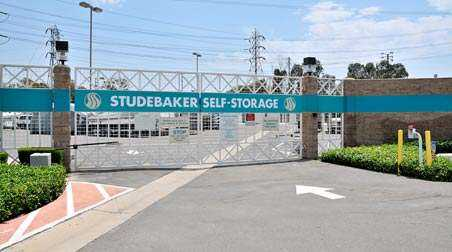 Gated entrance to Studebaker Self Storage outdoor storage area