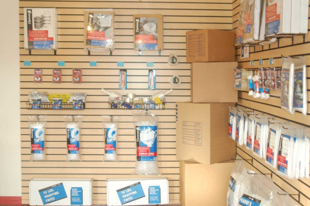 Moving and packing supplies displayed on a wall that are for sale
