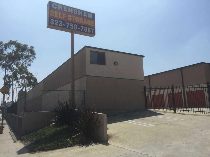 Street entrance to Crenshaw Self Storage facility with a gated entrance
