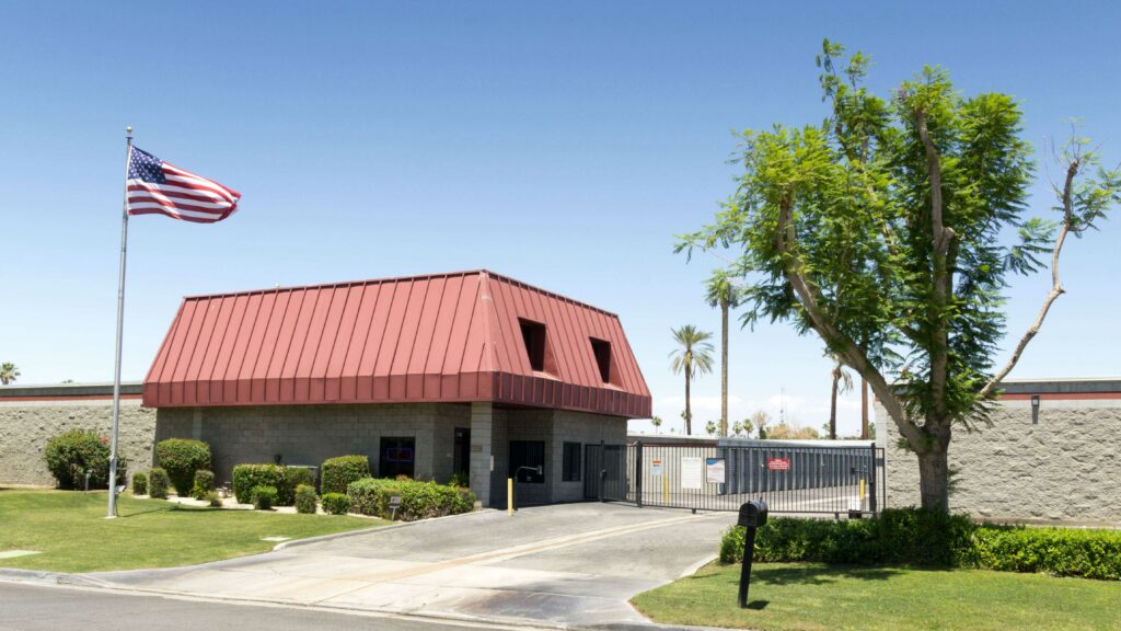 Street entrance to storage facility and gate to outdoor storage units
