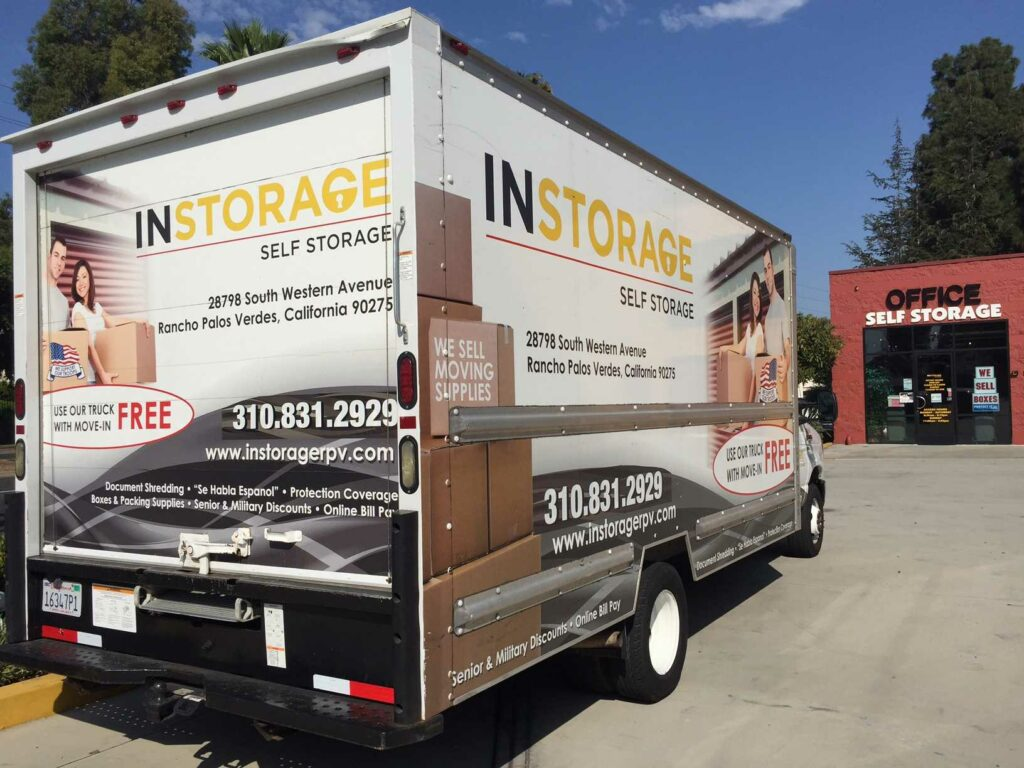 An Instorage Self Storage moving truck in front of the facility office
