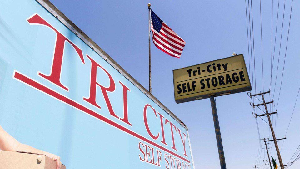 An angled up view of a Tri-City Self Storage street sign