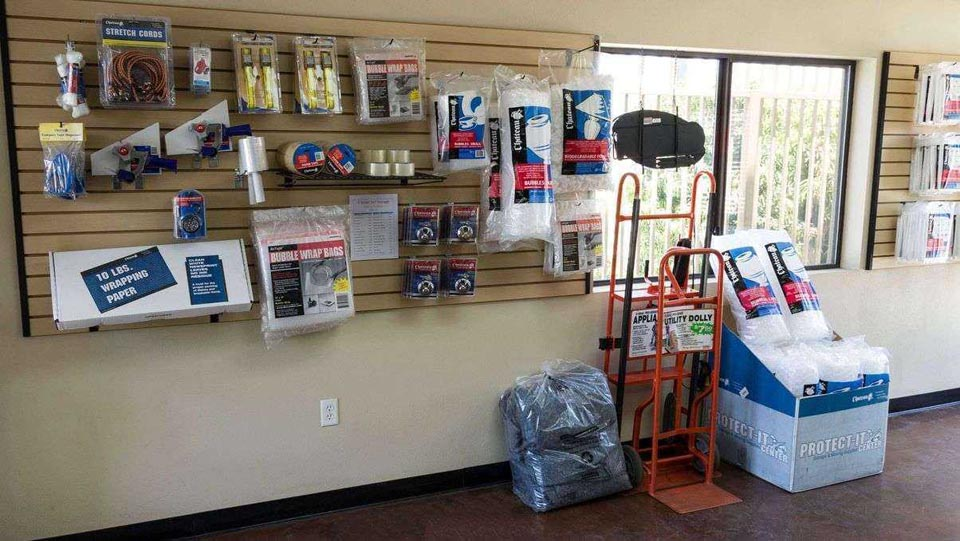 Inside facility office with moving and packing supplies for sale and dollies available