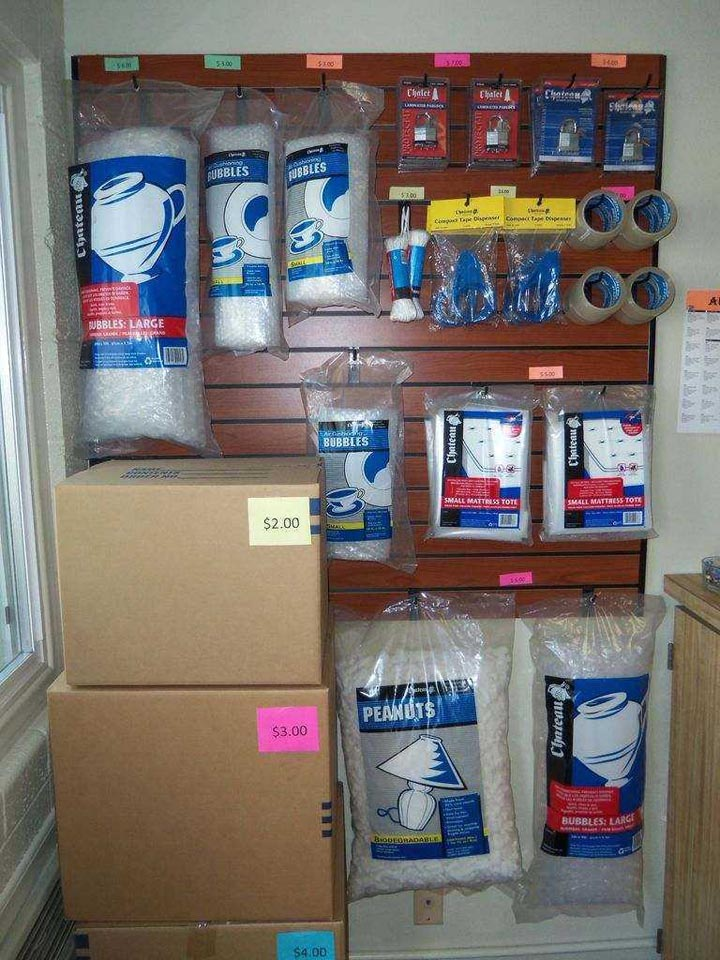 Moving and packing supplies on display against wall and are for sale