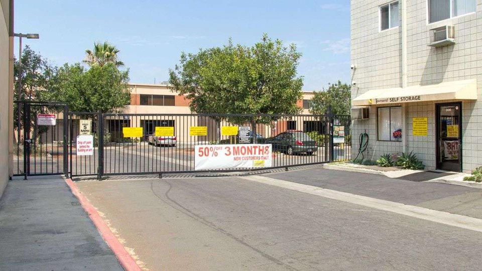 Gated entrance to outdoor storage area with a promotion of 50% off 3 months
