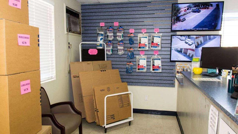Front desk area with moving and packing supplies available at facility office