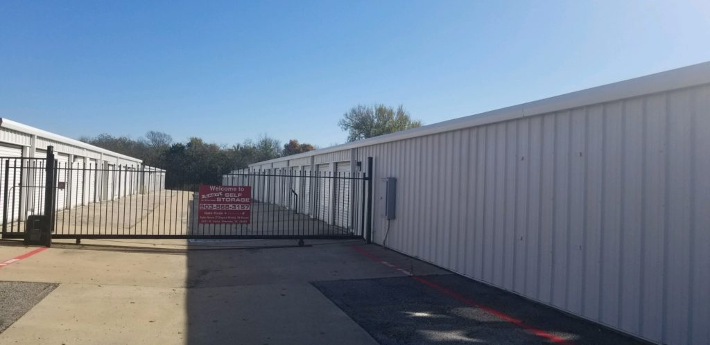 Gated entrance to outdoor storage unit area