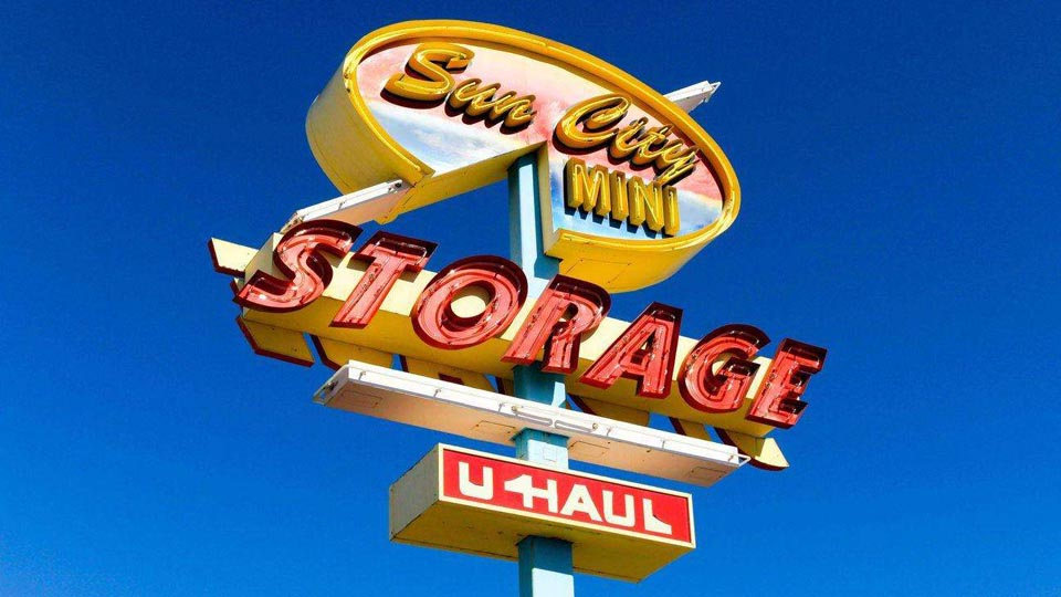 Street sign for Sun City Mini Storage and U-Haul
