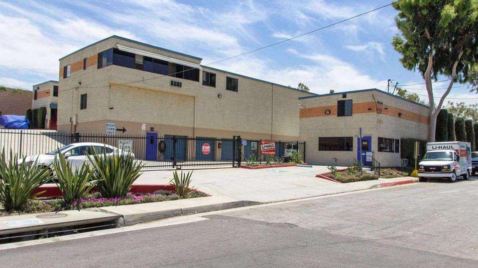 Street side view of gated entrance to Best RV and Self Storage