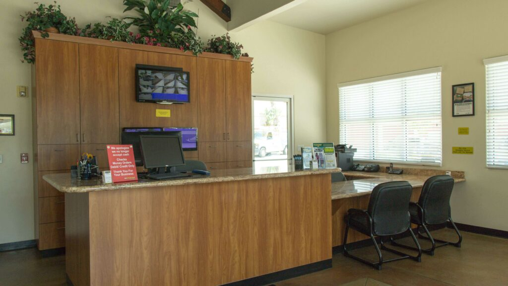 Inside a facility office with a front desk area and a seating area