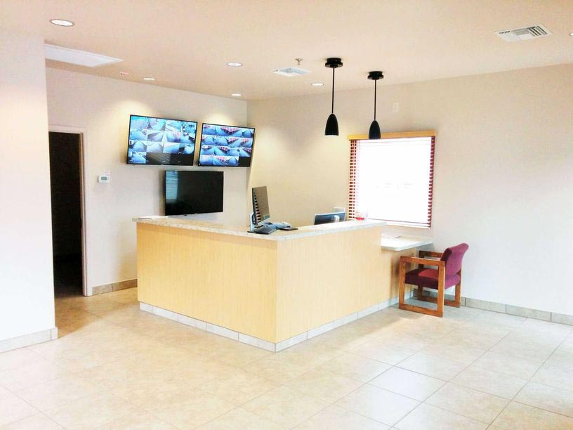 Office front desk with video surveillance of storage facility