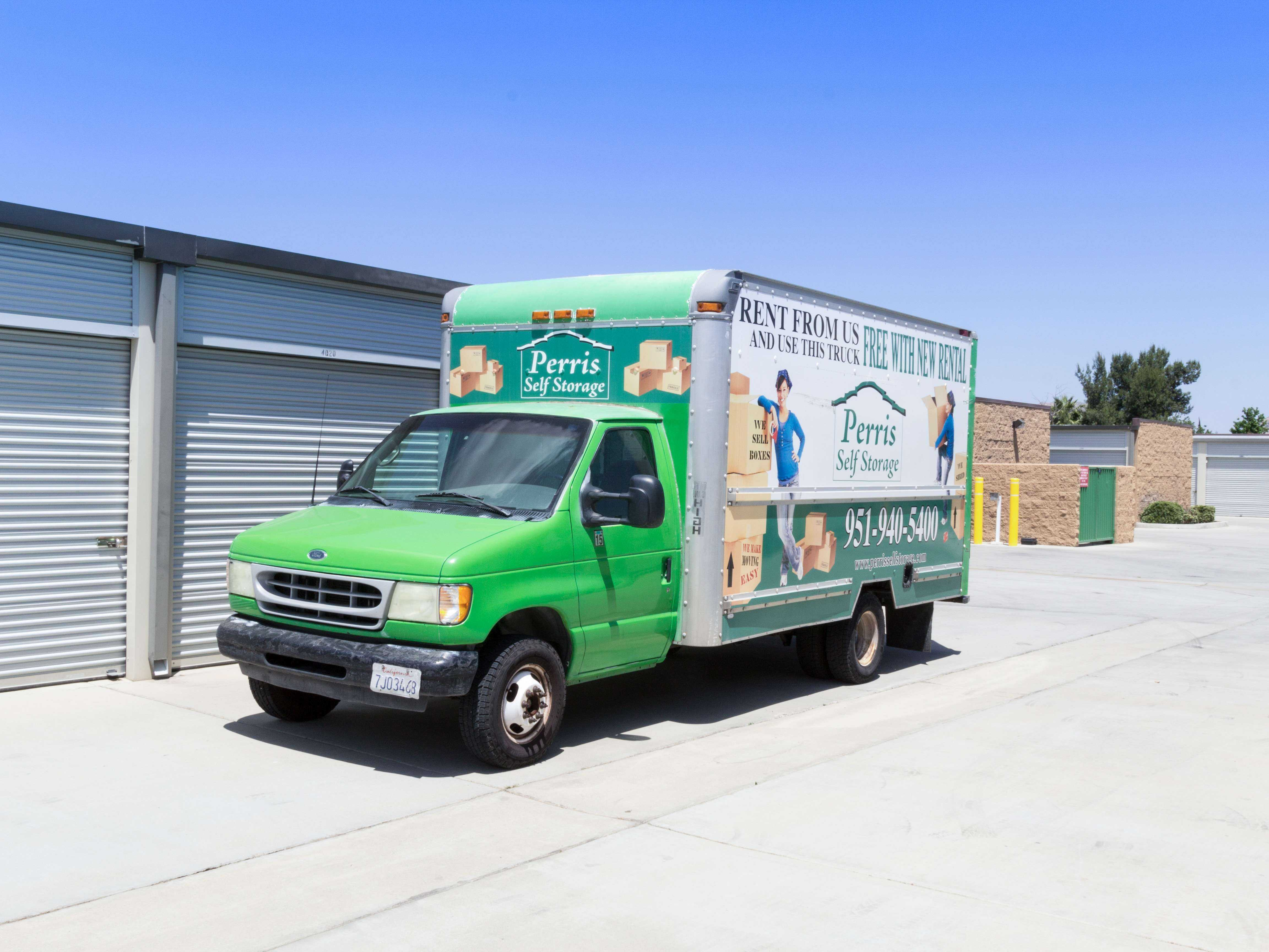Perris Self Storage moving truck parked outside by outdoor storage units