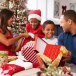 A family gathered around opening Christmas gifts