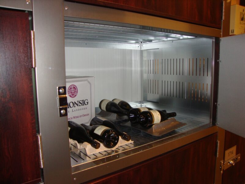Inside look into a small storage locker with wine bottles inside